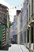 Guernsey, St Peter Port : Mill Street. Once trendy, today a shadow of its former self